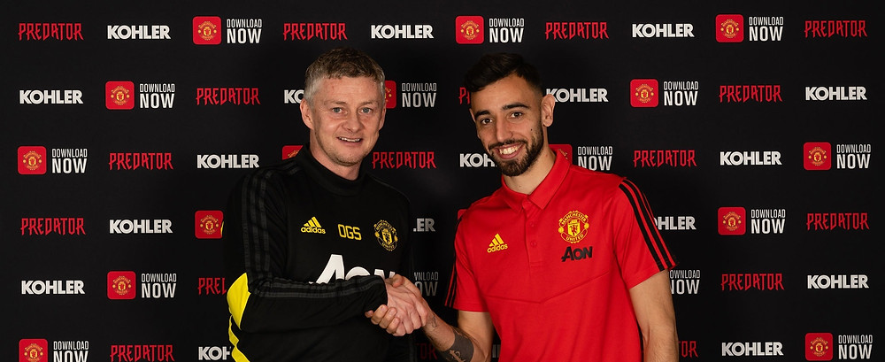 Bruno Fernandes of Manchester United poses with Manager Ole Gunnar Solskjaer after signing for the club at Aon Training Complex [Getty]