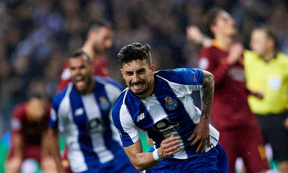 Porto's Alex Telles celebrates scoring a VAR penalty in extra time to eliminate Roma. [Quality Sport Images/Getty Images]