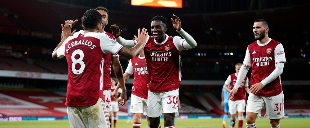 Eddie Nketiah of Arsenal celebrates with teammate Dani Ceballos [Getty]