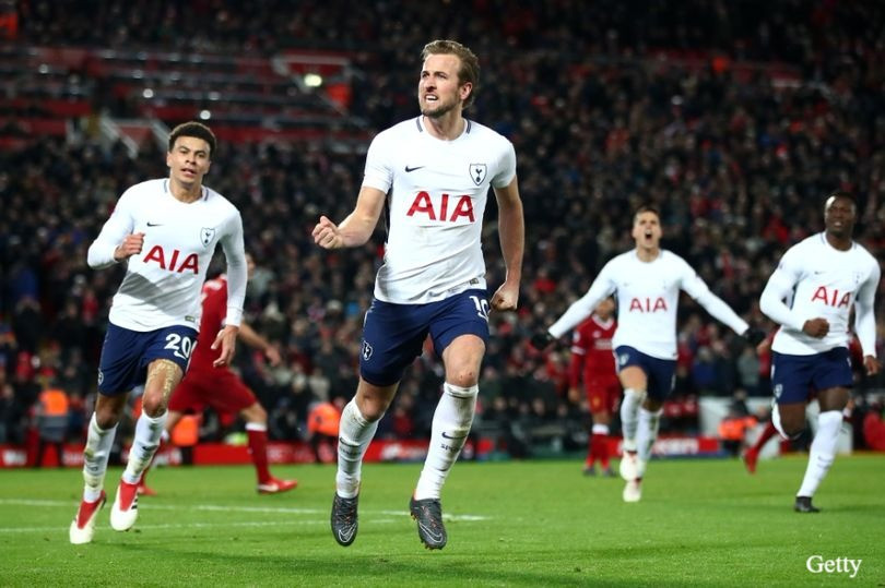 Harry Kane celebrates his 100th Premier League goal at Anfield.