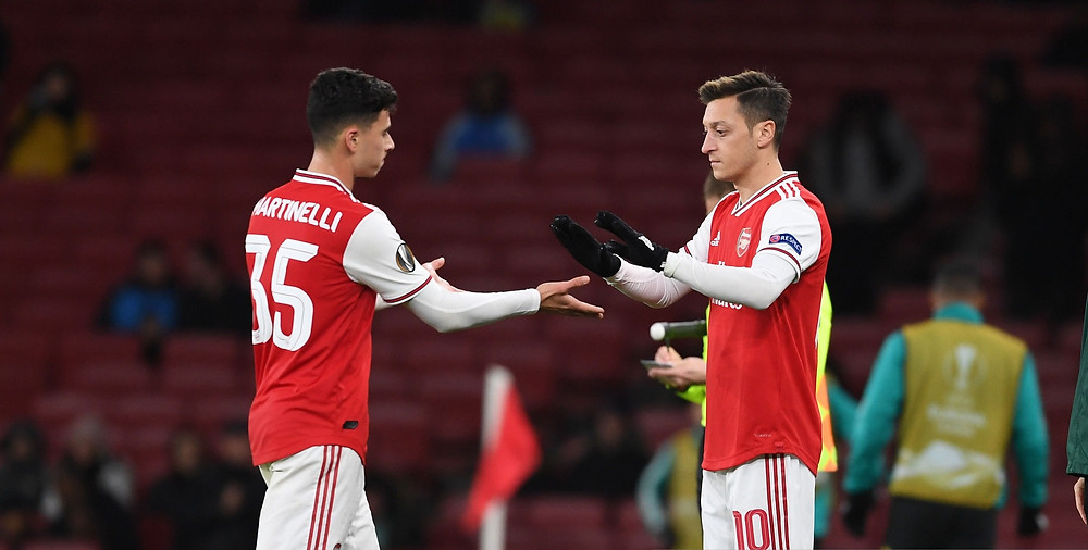 Ozil (L) hasn't featured for the Gunners since the Premier League restart [Getty]