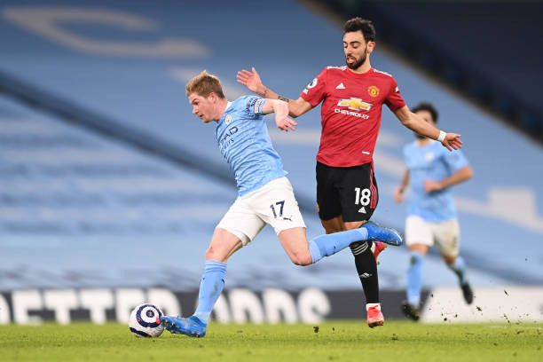 Kevin de Bruyne and Bruno Fernandes in the Manchester derby [Getty]
