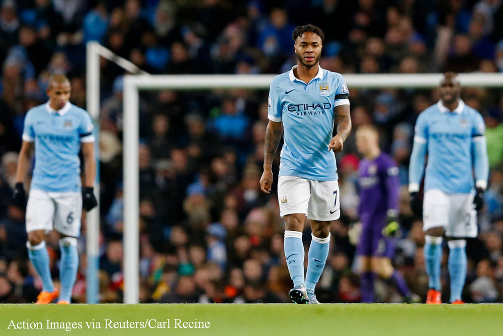 Sterling and teammates looks dejected as Liverpool run the Etihad last term