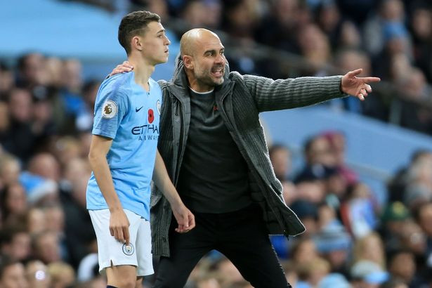 Foden receives instruction from Pep.