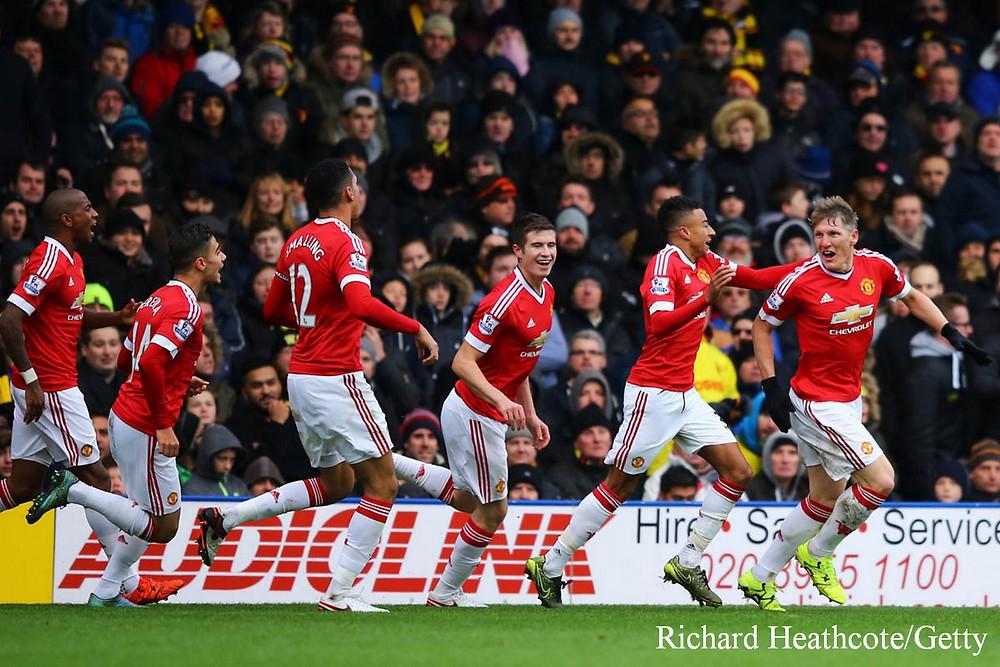 Schweinsteiger celebrating with his Man Utd teammates
