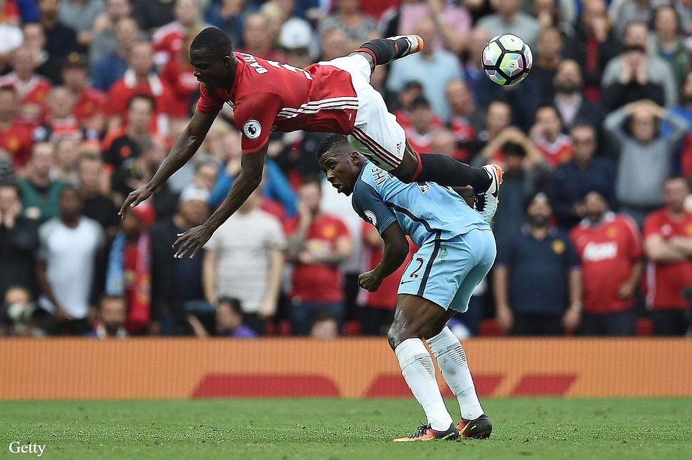 Bailly and Ihenacho battle for the ball in the Manchester derby.