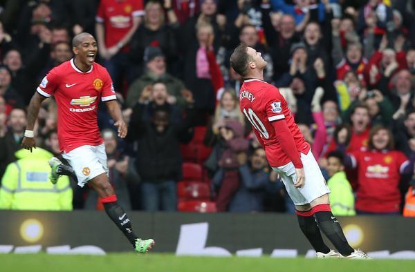 Rooney celebrates.