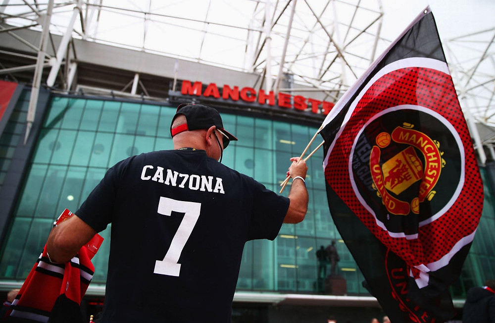 A Manchester United fan shows his allegiance.