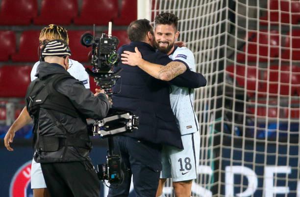 Frank Lampard embraces match winner Olivier Giroud. [Getty]