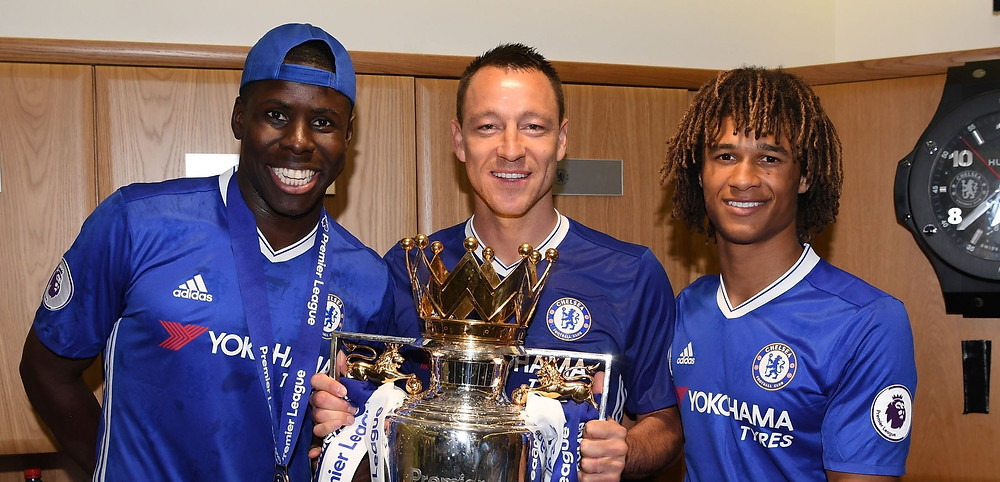 Kurt Zouma of Chelsea, John Terry of Chelsea and Nathan Ake of Chelsea pose with the Premier League Trophy. [Getty]