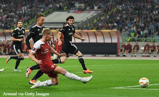Smith Rowe slots home Arsenal's second goal of the Europa League clash in Baku