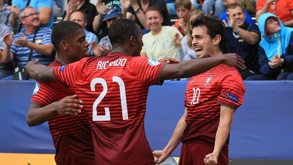 Bernardo Silva of Portugal (R) celebrates scoring with his teammates during the UEFA Under 21 European Championship 2015 semi final. [AFP]