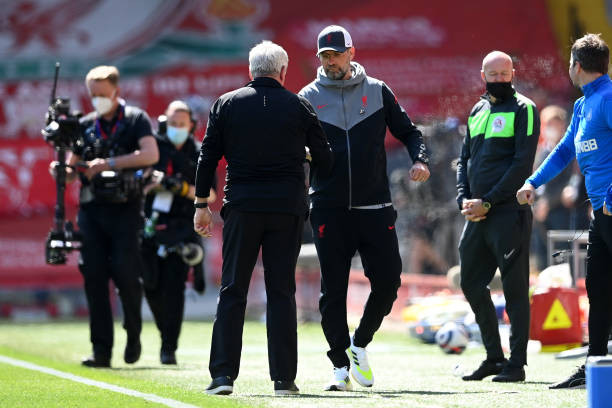Klopp and Steve Bruce shaking hands at Anfield. [Getty]
