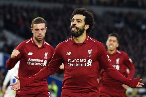 Mo Salah celebrates after scoring.