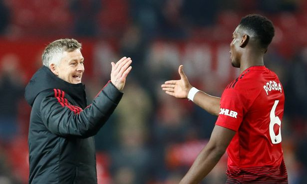 Ole Gunnar Solskjaer and Paul Pogba after Bournemouth win at Old Trafford.