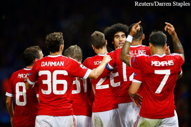 Fellaini celebrates with the team.