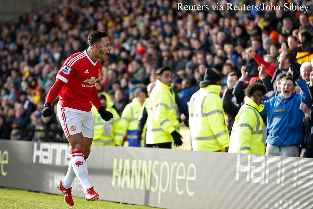 Depay celebrates with the United fans after his goal v Watford