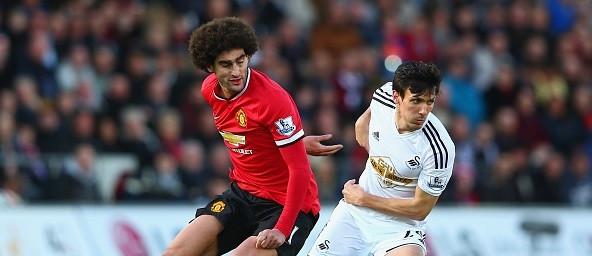 Fellaini battles with Swansea Jack Cork