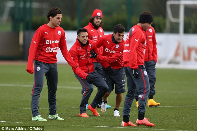 Sanchez in training with his Chile team-mates.