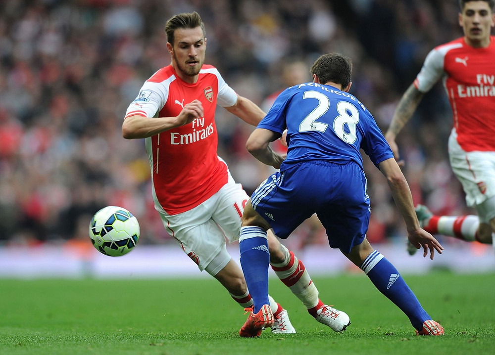 Aaron Ramsey (left).
