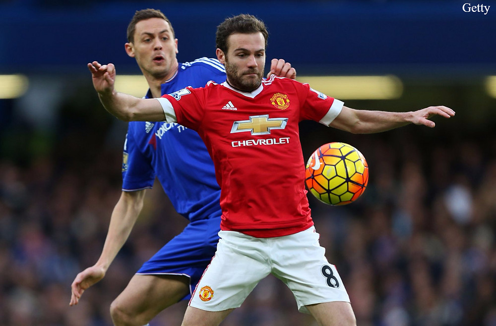Mata and Matic battle for the ball..