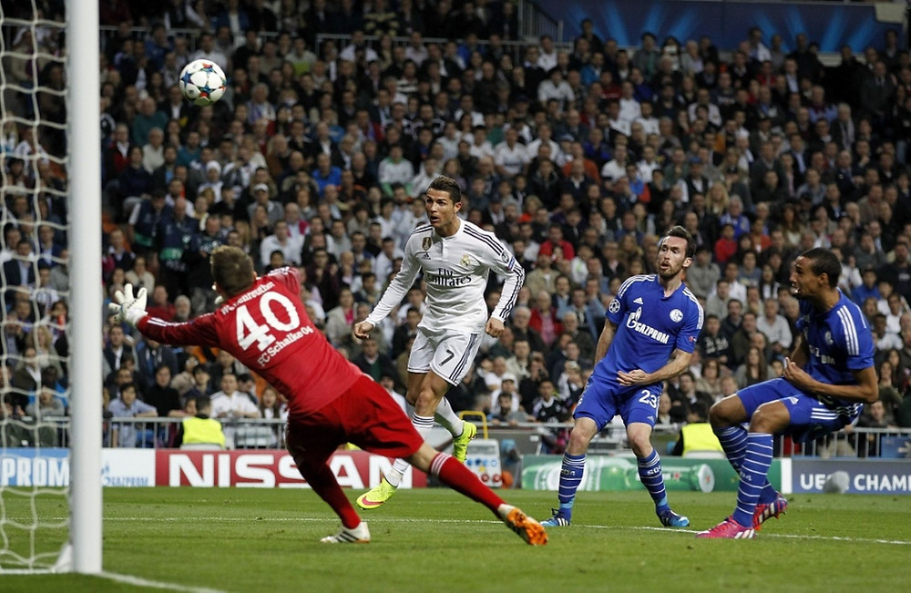 Cristiano Ronaldo heads the ball to score his team's second goal.