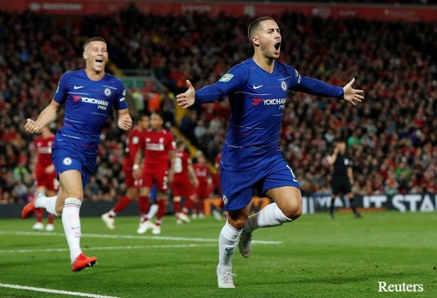 Eden Hazard celebrates after scoring a sublime individual goal at Anfield. [Reuters]