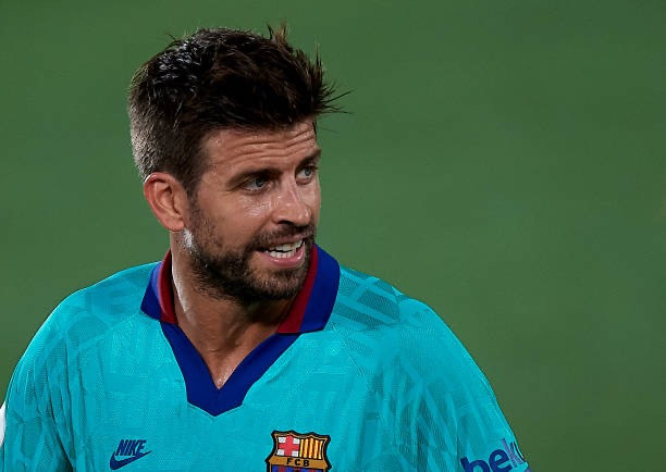 Barca defender Pique urges his teammates to keep pushing. [Getty]