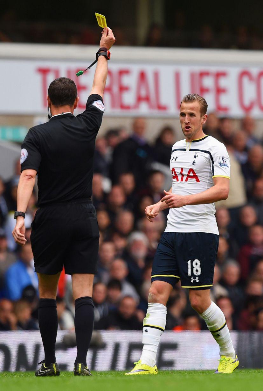 Harry Kane receiving a yellow card.