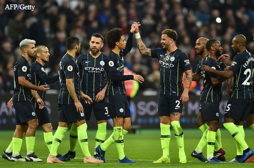 Man City players celebrate.