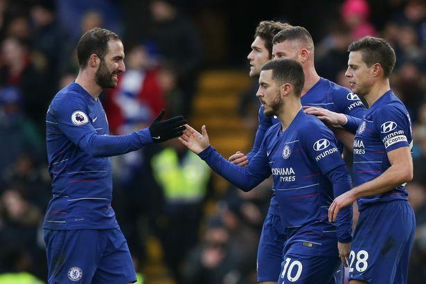 Higuain, Eden Hazard and Chelsea teammates celebrate. (AFP/Getty Images)
