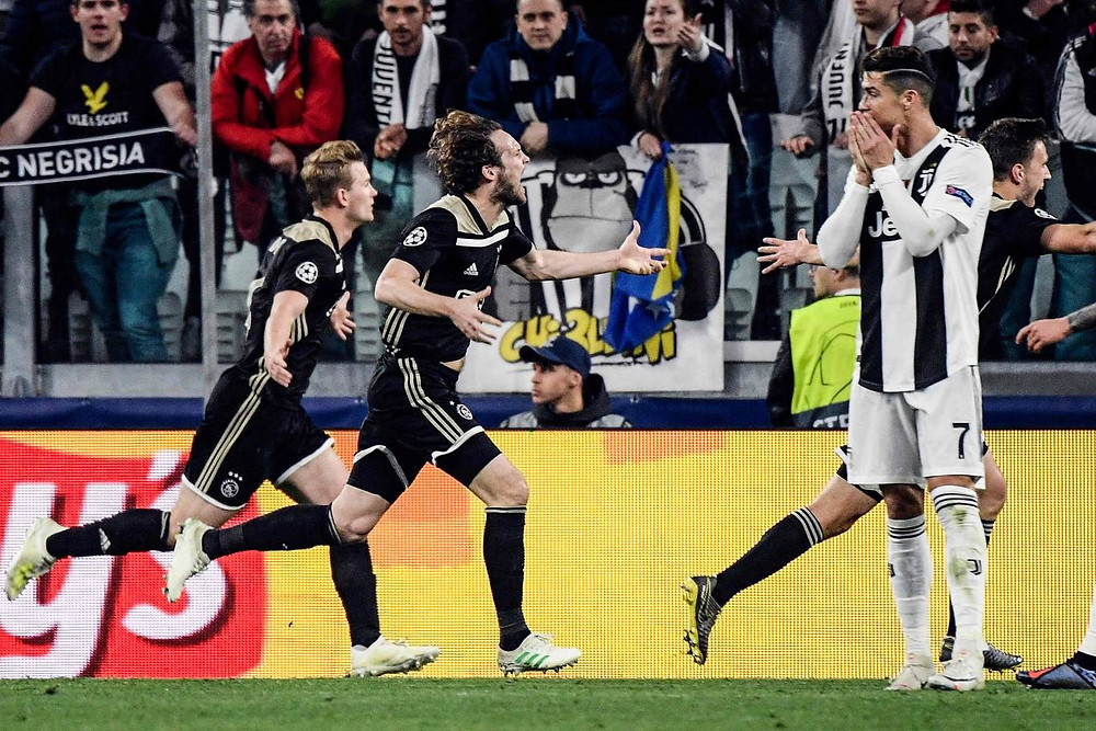 Blind celebrates for Ajax. [AFP/Getty Images]