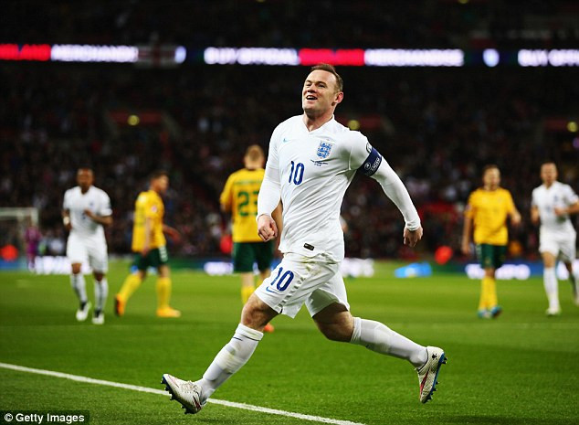 Rooney as he celebrates his goal against Lithuania at Wembley.