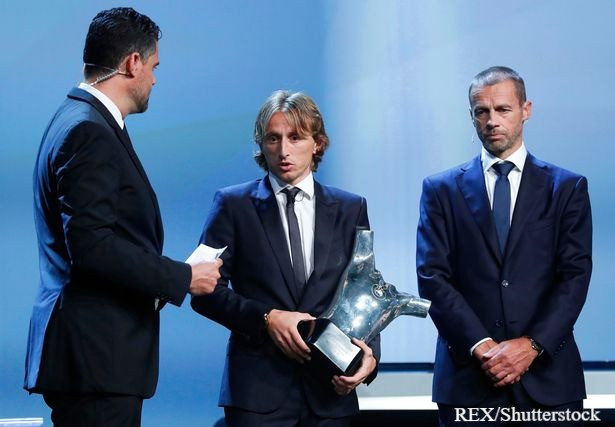 Modric receives the UEFA Player of the Year award.