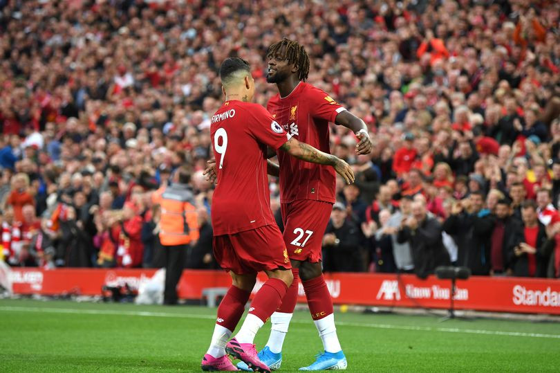 Divock Origi and Roberto Firmino celebrates after Grant Hanley of Norwich City scores an own goal during the Premier League match between Liverpool FC and Norwich City at Anfield on August 09, 2019 (Image: Photo by Michael Regan/Getty Images)