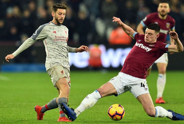 Lallana and Declan Rice vying for the ball. (Image: AFP/Getty Images)