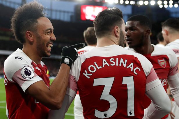Aubameyang celebrates with his Arsenal teammates. [Getty Images]