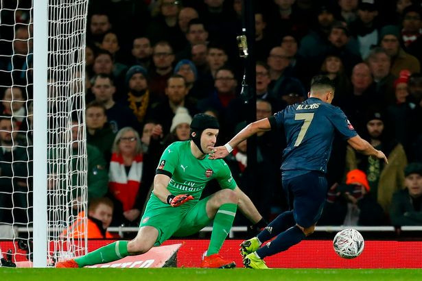 Sanchez rounds Cech to open the scoring (Image: AFP/Getty Images)