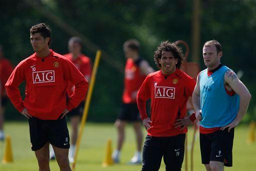 Ex-Man Utd stars Ronaldo, Tevez and Rooney formed a devastating front three at Old Trafford. [Getty]