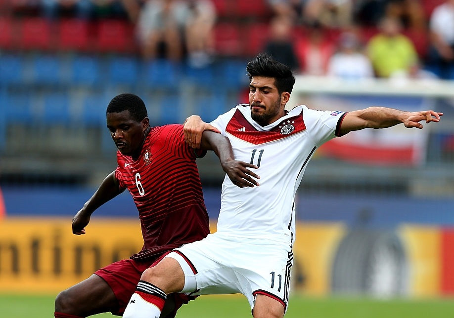 William Carvalho (L) of Portugal and Emre Can of Germany battle for the ball during the UEFA European Under-21 semi final match Between Portugal and Germany at Ander Stadium on June 27, 2015 in Olomouc, Czech Republic. [Getty Images/Martin Rose].