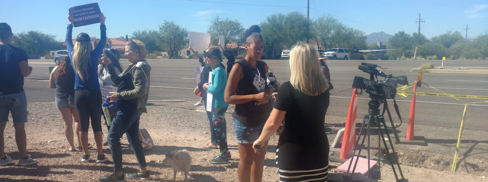 Kristen Godfrey, #Fight4HER Tucson Organizer, discusses speaks with reporters at the #StopKavanaugh rally in Tuscon, AZ.