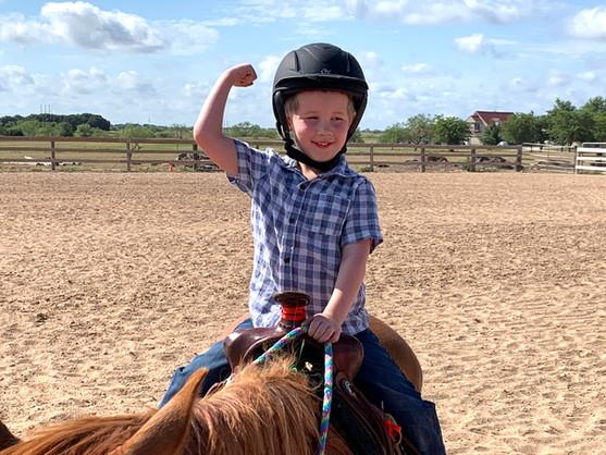 Little boy riding horse HOTEA Horse Camp