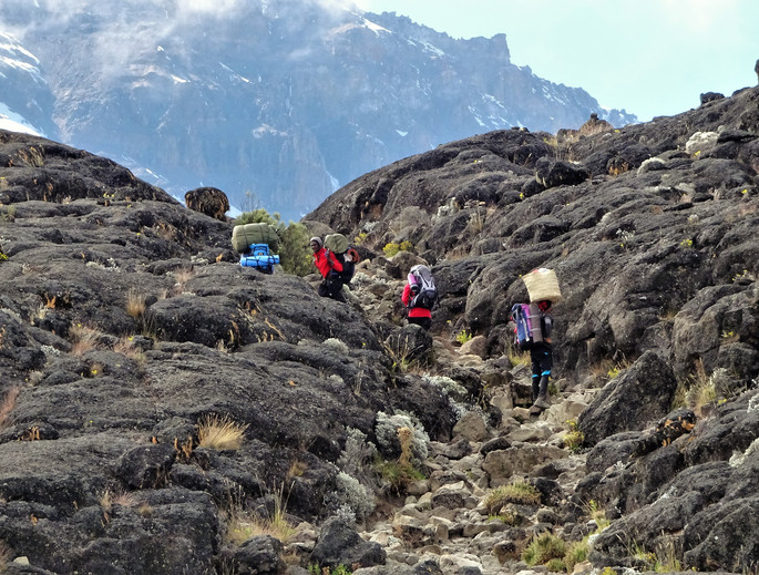 Our porters, climbing up the rocks