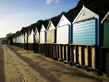 beach huts, dorset, england