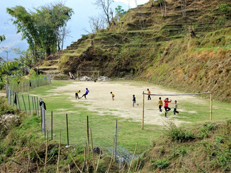 Soccer, on a rare patch of flat land