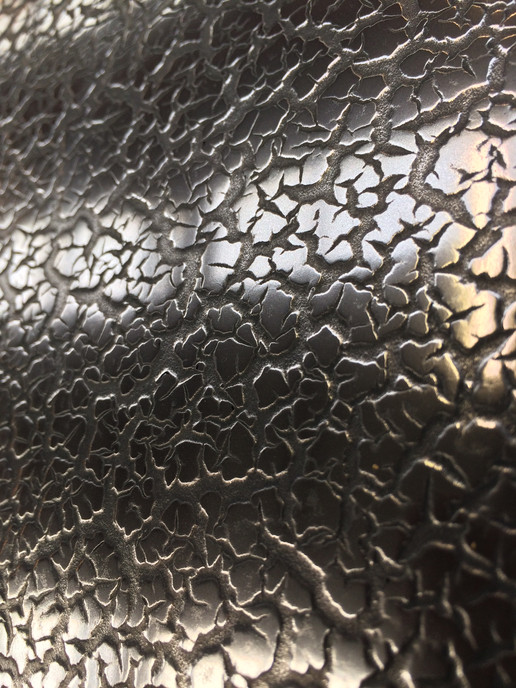 Cracked Gunmetal Surface