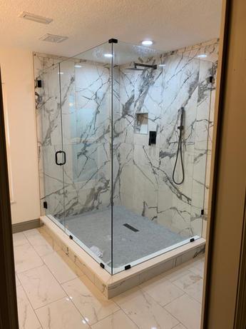 Custom frameless glass shower enclosure