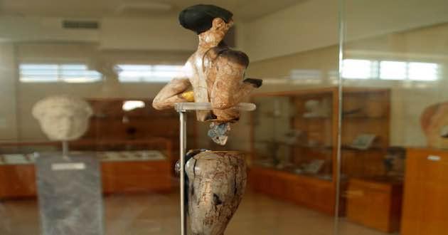 Gold hippopotamus ivory statue.