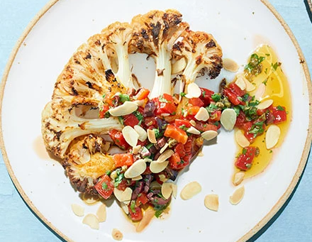 CAULIFLOWER STEAKS WITH ROASTED RED PEPPER AND OLIVE SALSA