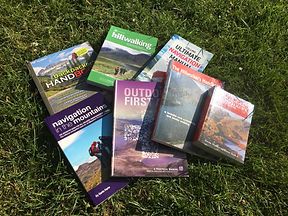 Some of the books available to borrow from Camp 404 as you prepare for your first wild camping expedition